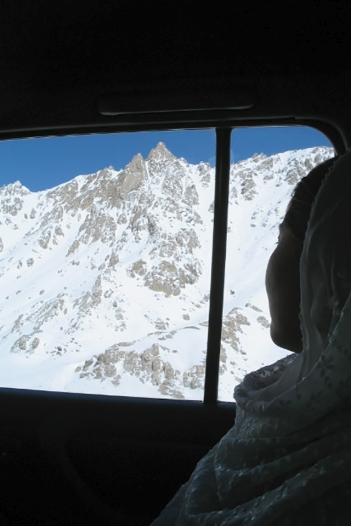 Afghanistan: A young Hazara woman viewing the Hindu Kush, central Afghanistan